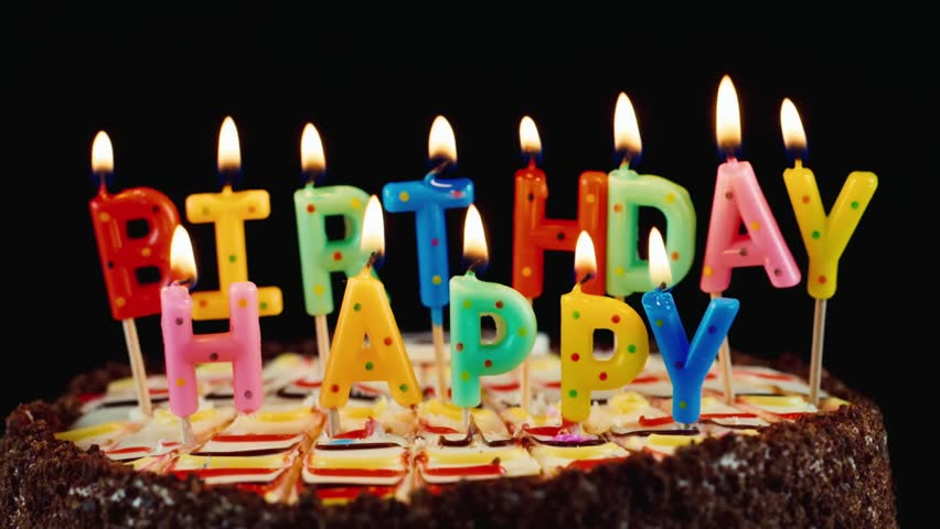 Lighted Candles On A Happy Birthday Cake. Candles With The ...