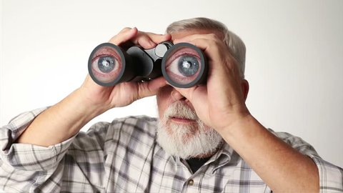 Senior adult male looking through binoculars with a surprised expression on his face.