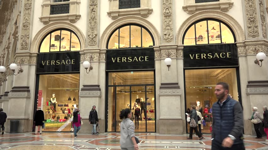 MILAN, ITALY - OCTOBER 2015 - Versace store in Galleria Vittorio Emanuele. Fashion industry and people shopping in shops and stores, Milano, Italia. City view of Milan, Italy