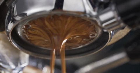 coffee extraction with bottomless portafilter on professional espresso machine, 4k 60fps footage