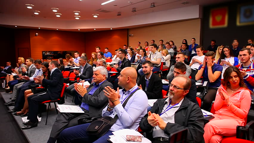 MONTENEGRO - PODGORICA 2015 - Group of people applauding in the conference hall