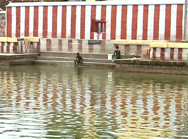 TAMIL NADU, INDIA – FEBRUARY 2000 –Pilgrims bathing in a temple tank in South India.
