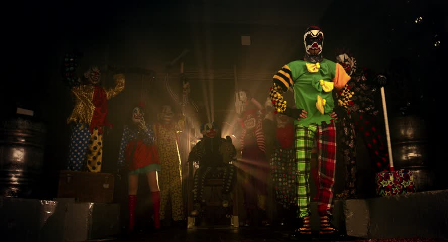 Party of clowns. Clowns dancing and intimidating weapons. Halloween. | Shutterstock HD Video #12106676