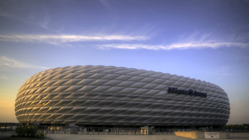 MUNICH, GERMANY - APRIL 23: Timelapse of Allianz Arena, April 23, 2011 in Munich, Germany. Allianz Arena is the first stadium in the world that has a full changing color outside.