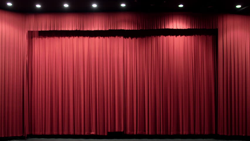 Red theater curtain opens to reveal movie screen. Originally recorded in 4K and cropped.