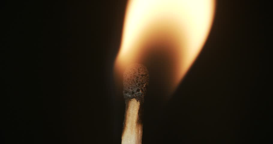 Pack of Man lights a match in darkness. Slow Motion