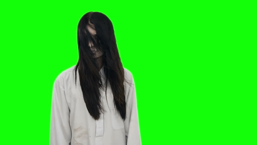 Ghost girl with long black hair and wearing a white shirt at the Chroma key.