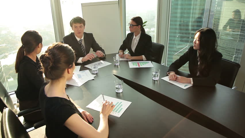 Young business partners greet each other before meeting | Shutterstock HD Video #12187319
