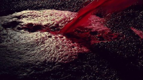 Production footage of red wine being poured into wine vat with winemaker testing and tasting red wine in winery cellar after vintage and harvest. Include Barossa, Clare, Hunter, Tanunda, Yarra, Valley