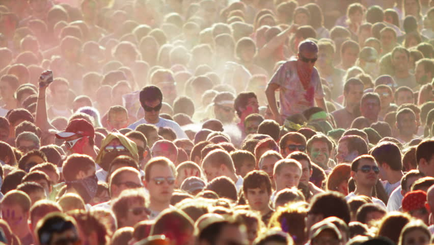 Spanish Fork, Utah-United States - March 2005: crowd of people at a Hindu festival throwing colored powder into the air | Shutterstock HD Video #12251489