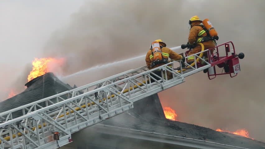 Quebec, Canada - July 2015 - Firefighters battle blazing house fire.
