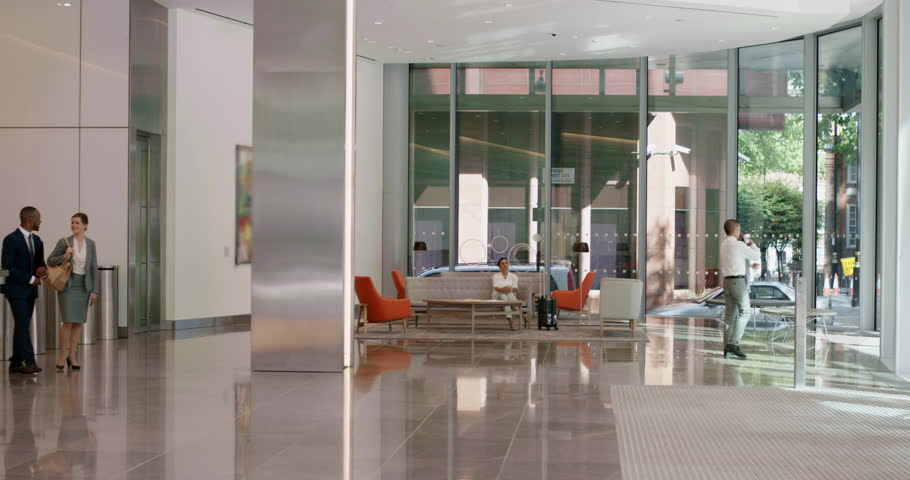 corporate office lobby. portrait of business woman at work in busy corporate office lobby smiling with confidence leadership strategy concept stock footage video 12323759 |