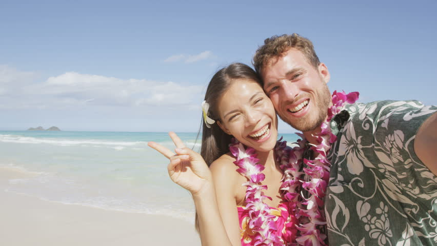 Couple On Beach Taking Selfie Photo Hawaii With Smart Phone Young Woman And Man