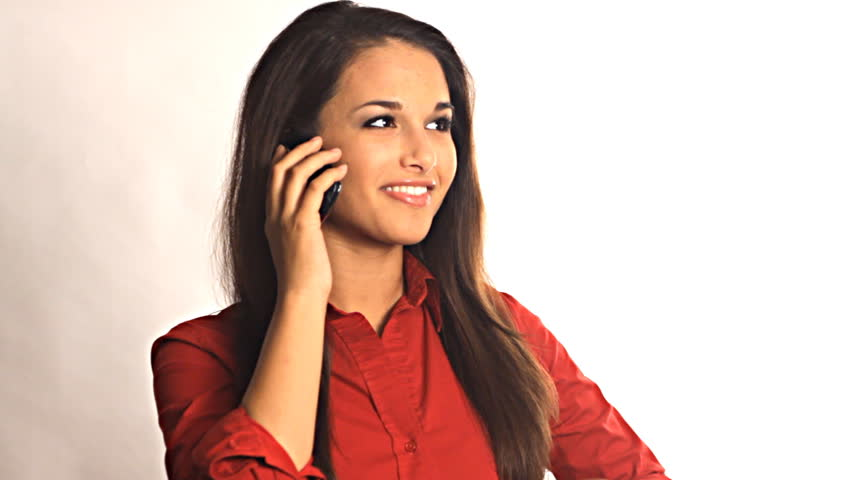 Young pretty business woman talking on smart phone