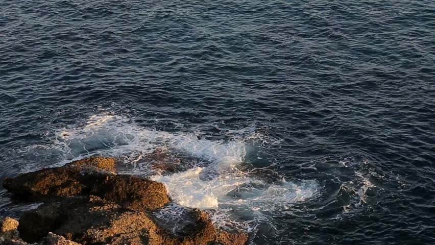 mediterranean sea with splashing waves against the rock  #12442079
