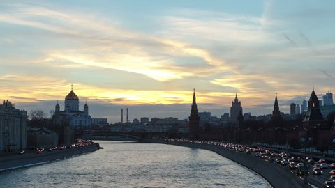 Russia. Ensemble of Moscow Kremlin and Moskva-City business center view across Moskva river at a winter day to night transition timelapse hyperlapse 4K