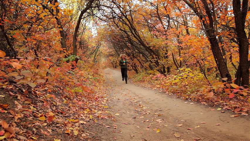 Blonde girl runs in the autumn forest | Shutterstock HD Video #12538079