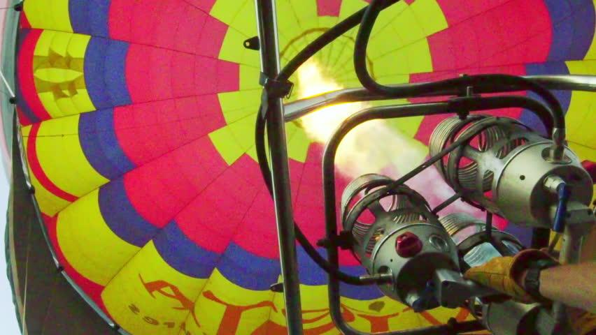 Flame burners heat up the air inside a hot air balloon  | Shutterstock HD Video #12550949