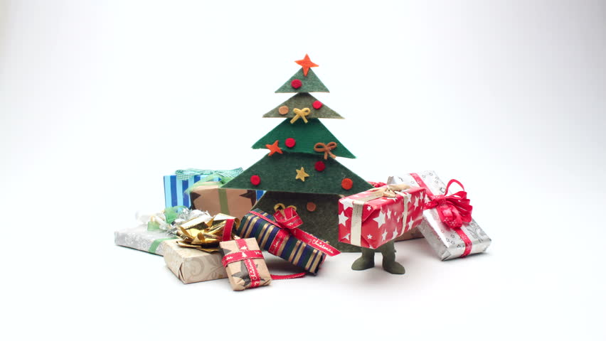 Moving Christmas Gifts With Legs Sitting Under Christmas Tree. Stop Motion  Animation   4K Stock