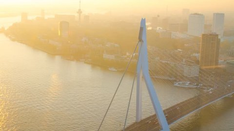 Static timelapse of the famous erasmus bridge at sunset and the urban skyline of one of europe's biggest harbours in the back, Rotterdam, the Netherlands