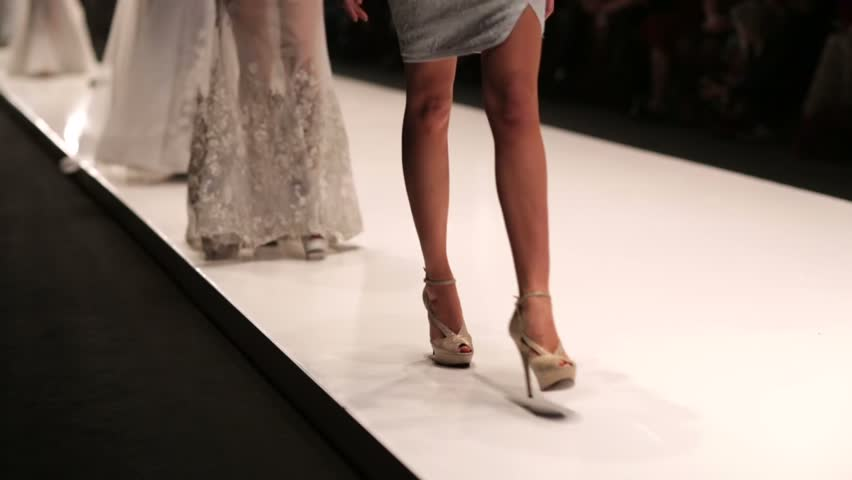 models walk the runway during fashion show.
