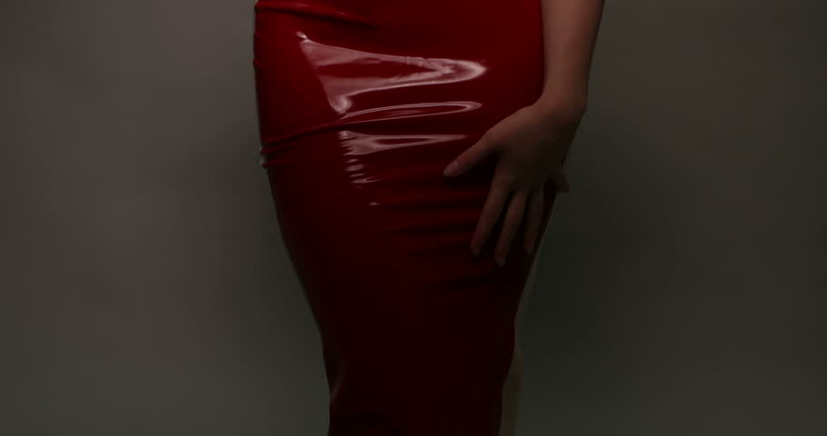 Leather driving gloves with zipper - Sensual Woman Wearing Red Latex Dress Moving Slowly On Grey Background