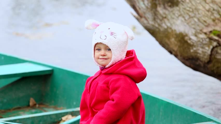 Beautiful Smiling Child Sitting In Wooden Boat On River Little Girl Portrait 1 Year