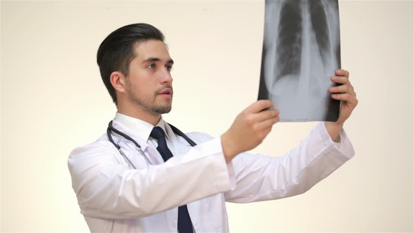 Stock video of respectable male doctor examines an x-ray. | 12728309 ...
