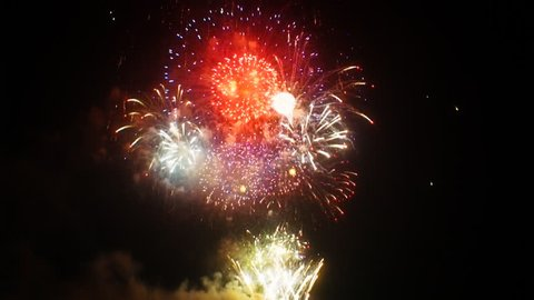 Gorgeous colorful fireworks exploding high in the air. FullHD 1080p.