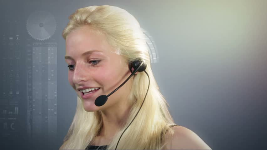 Call center employee on headset talking, surrounded by virtual graphs | Shutterstock HD Video #1277044