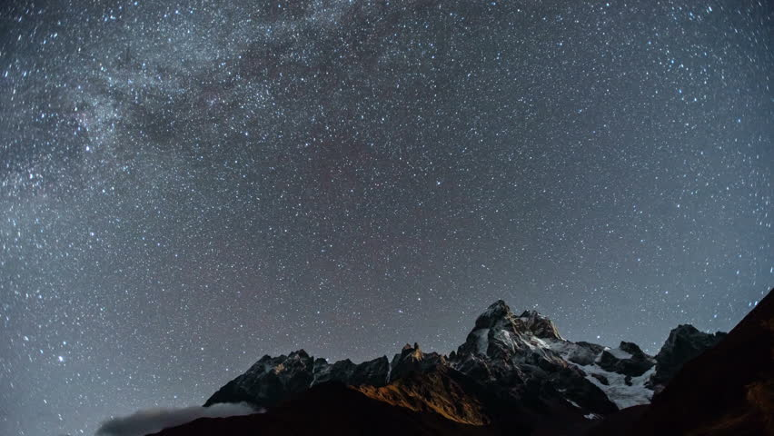 4K Timelapse of amazing starry night in touristic place the Ushba mountain, one of the most notable peaks of the Caucasus Mountains located in the Svaneti region of Georgia, filmed from Mheer.