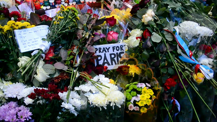 KIEV, UKRAINE - NOV 14: Flowers and candles memorable memorial set up near the French Embassy in Kiev, Ukraine on November 14, 2015 for the victims killed in attacks in Paris (France) on 13.11.15.