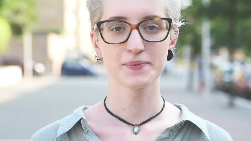 Video portrait of young handsome caucasian blonde hair designer woman looking in camera, wearing glasses, pensive – thoughtful, seriousness, thinking future concept   Shutterstock HD Video #12817109