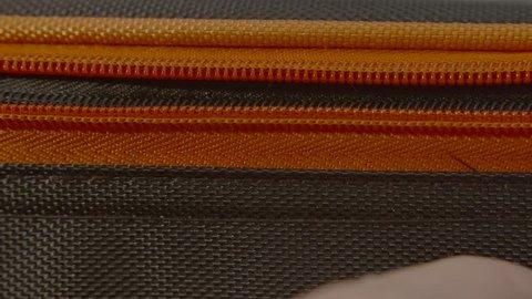 Zipping Up Zip on Suitcase / Luggage - Close Up, Macro