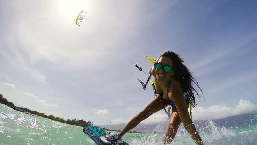 Young Woman Kitesurfing in Ocean in Bikini. Extreme Summer Sports POV GOPRO Slow Motion.