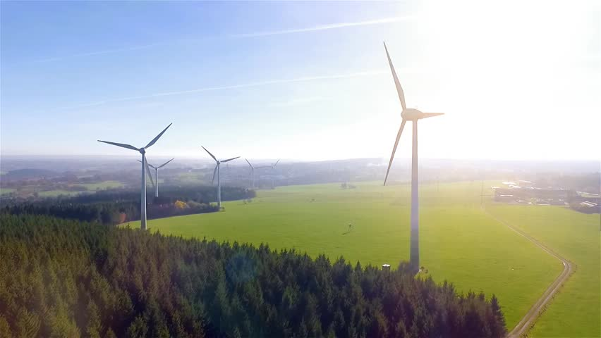 Windmill / Wind power technology - Aerial drone Birds eye view on Wind Power also know as wind turbine, Windmill, Energy Production - Clean and Renewable Energy