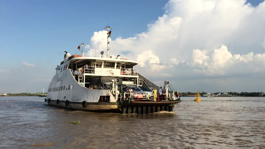 PHU HUU PORT, VIETNAM - OCTOBER 2, 2015: A Cat Lai ferry brings commuters across the Nha Be river. The way leads right to Ho Chi Minh City.