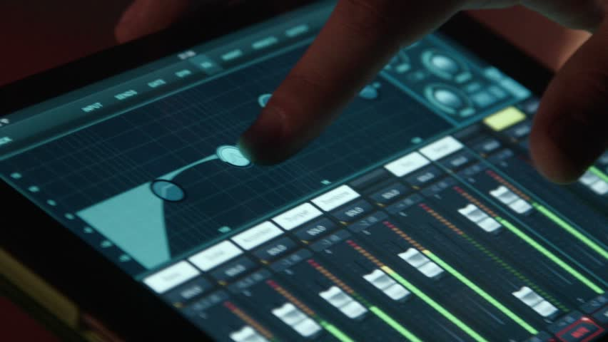 the sound producer remotely works with a sound on a stage using the touchpad
