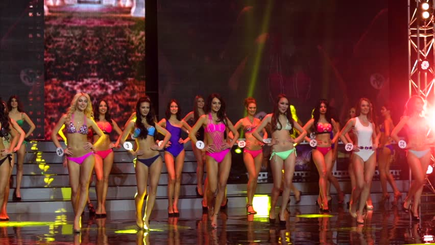"""MOSCOW, RUSSIA - NOVEMBER 18, 2015: The most beautiful girls of Russia compete on a stage in a swimwear competition during an annual national pageant  """"Krasa Rossii"""" (The Beauty of Russia)."""