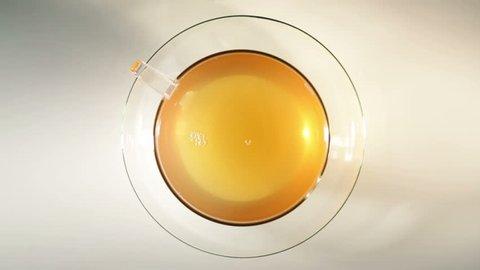 Green tea - top view/pouring tea - center composition