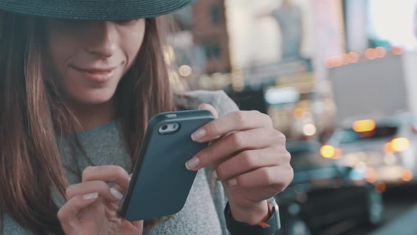 Typing on cell phone. Girl is Texting message  | Shutterstock HD Video #13078394