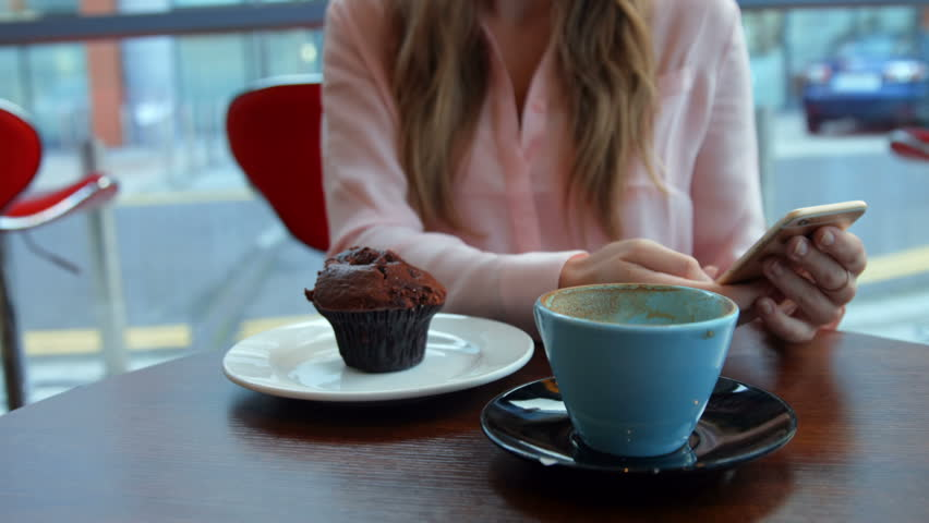 Pretty blonde having a coffee in high quality format - HD stock video clip