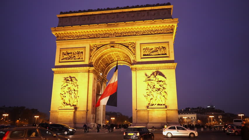 Triumphs arch called Arc de Triomphe with French flag in the evening | Shutterstock HD Video #13119269