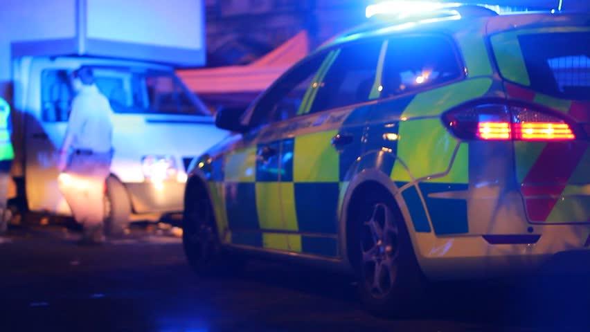 BRISTOL - July 6: Ambulance with Flashing Lights Siren Driving Through Street at Night at St Pauls Carnival - July 6 2013 in Bristol England