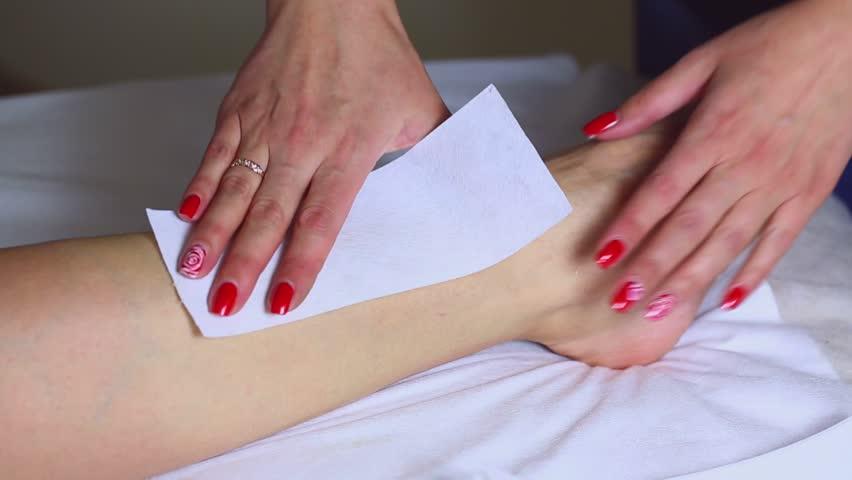 Woman in a beauty salon doing depilation | Shutterstock HD Video #13134959