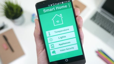 Changing the temperature with a smartphone smart house device.