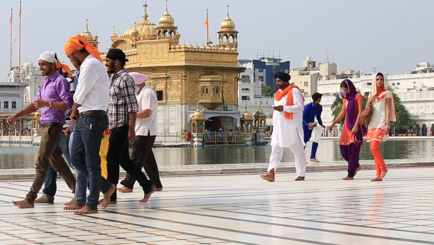 AMRITSAR, INDIA - SEPTEMBER 27, 2014: Unidentified Sikhs and indian people visiting the Golden Temple in Amritsar, Punjab, India. Sikh pilgrims travel from all over India to pray at this holy site.