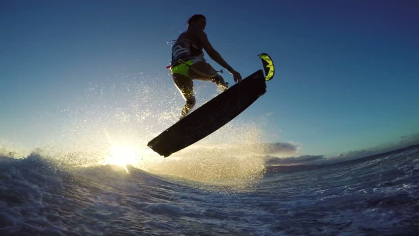 Girl Kite Surfing Catches Air Over Ocean Wave in Bikini Extreme Kitesurfing at Sunset. Summer Ocean Sport in Slow Motion.