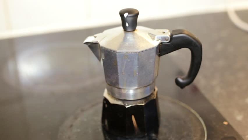 moka pot italian traditional coffee maker on a induction. Black Bedroom Furniture Sets. Home Design Ideas