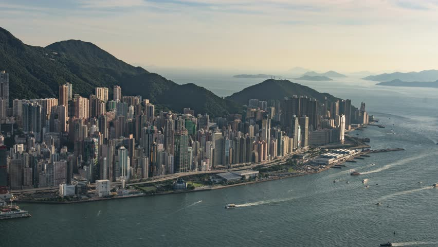 Aerial panorama view of Hong Kong Island at sunset. Modern financial and cultural asian city at Victoria Harbor. Time lapse | Shutterstock HD Video #13162445